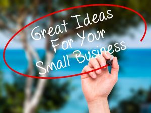 Man Hand writing Great Ideas For Your Small Business